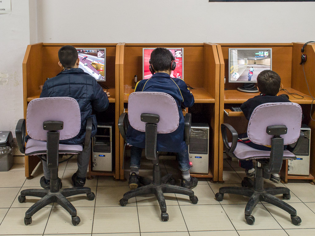 Children play war games in an internet cafe not far from a Syrian school.